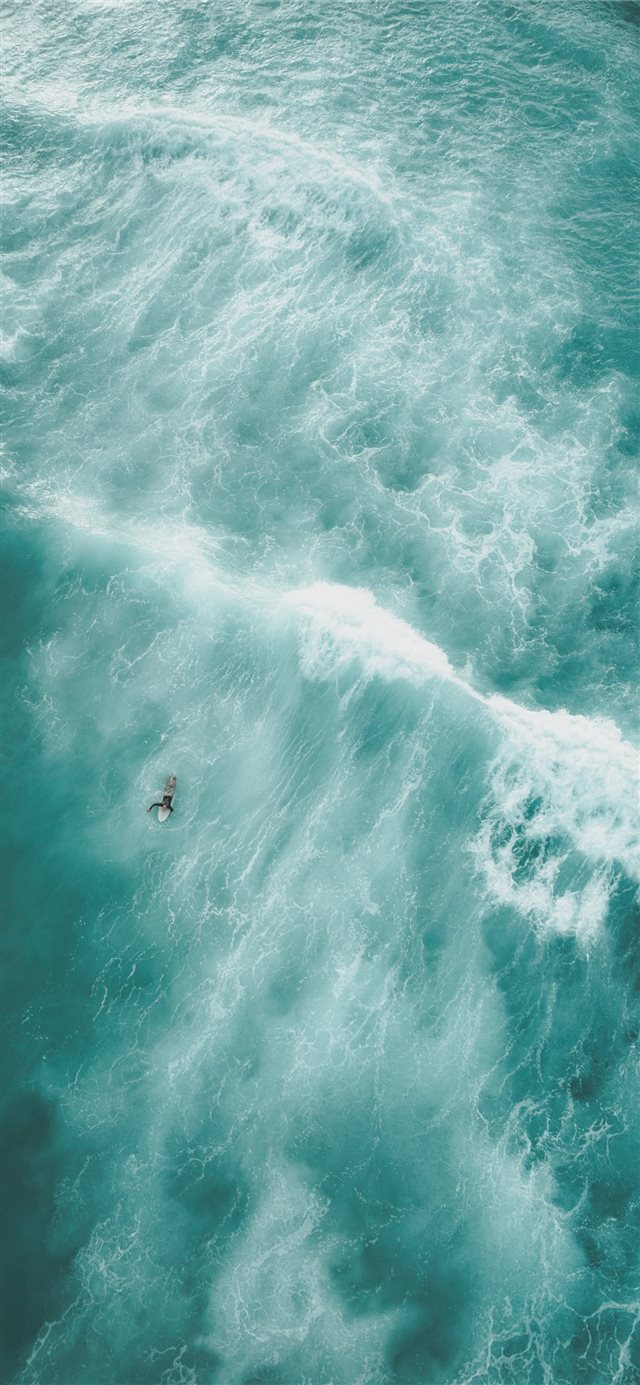 birds eye view photo of a person on body of water iPhone X wallpaper