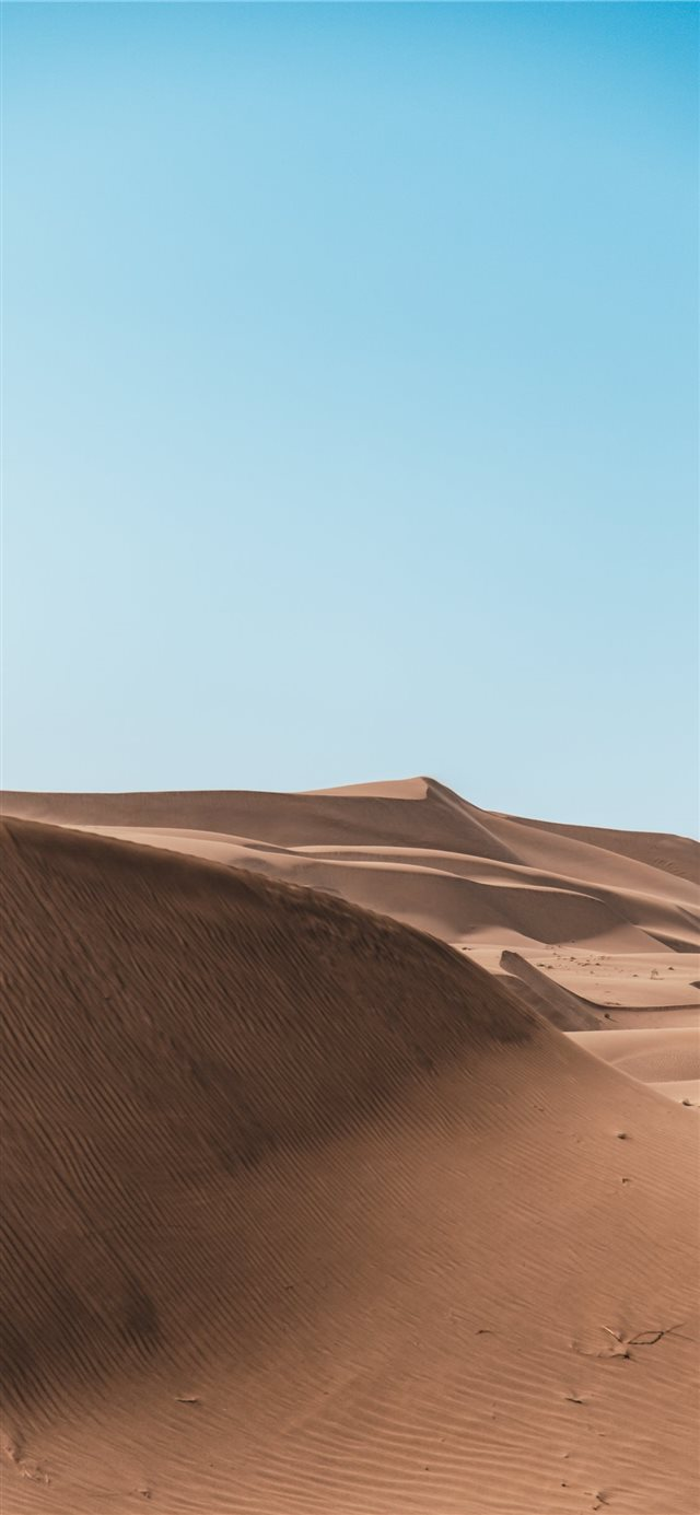 brown sand under white cloudy sky iPhone X wallpaper