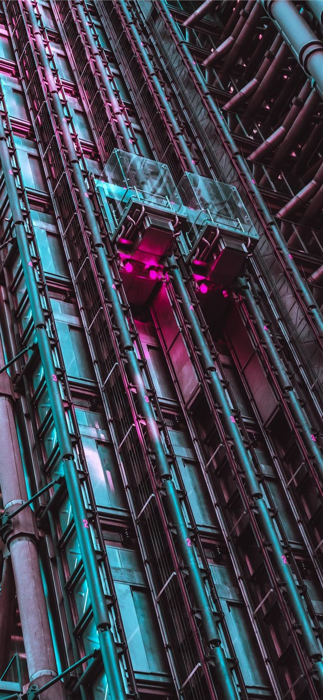 gray high rise building iPhone 11 wallpaper