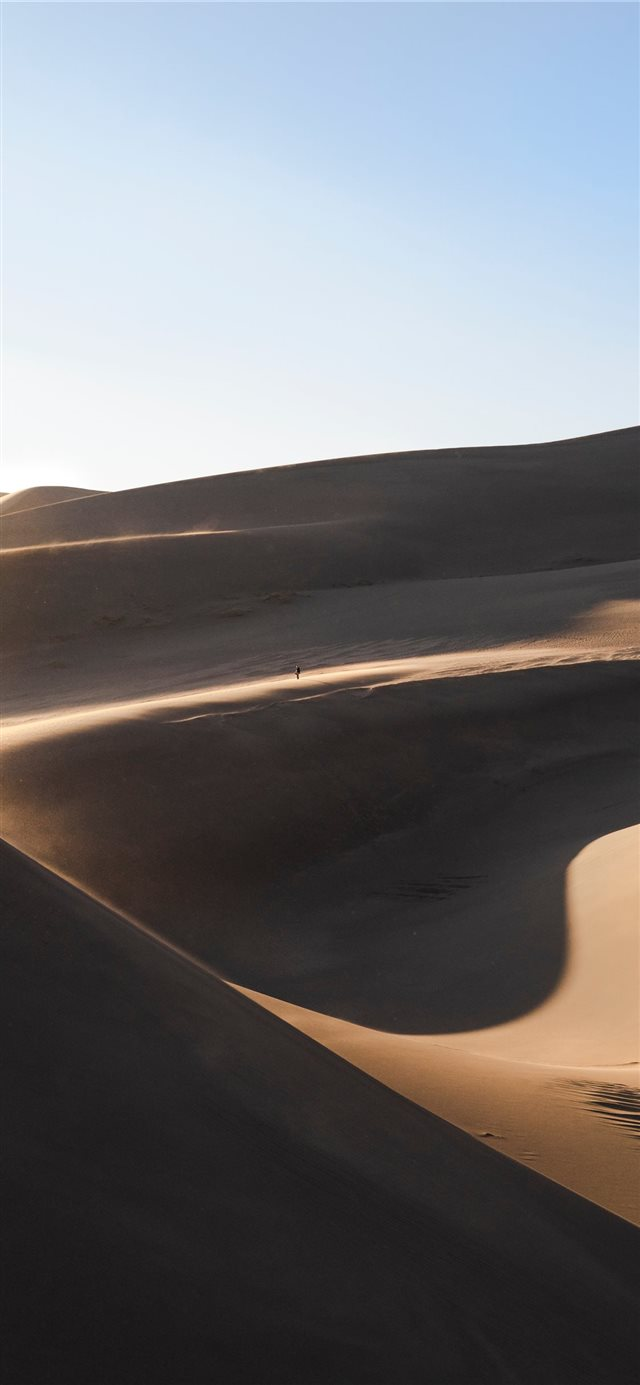landscsape photography of desert field iPhone X wallpaper