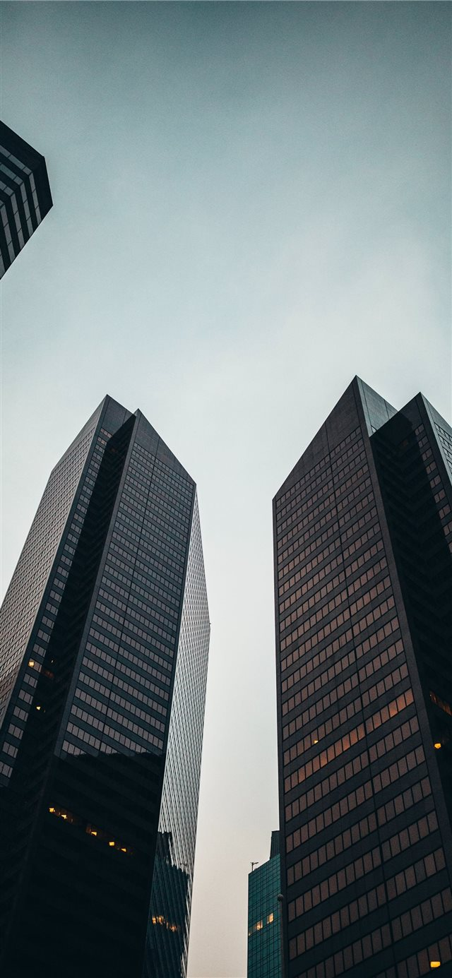 low angle photo of high rise building during dayti... iPhone X wallpaper