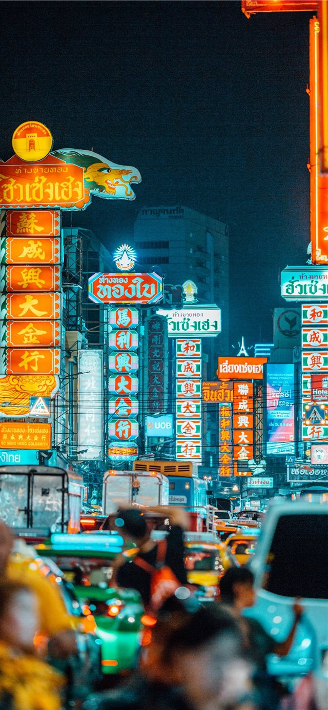 people walking on streets at nighttime iPhone X wallpaper