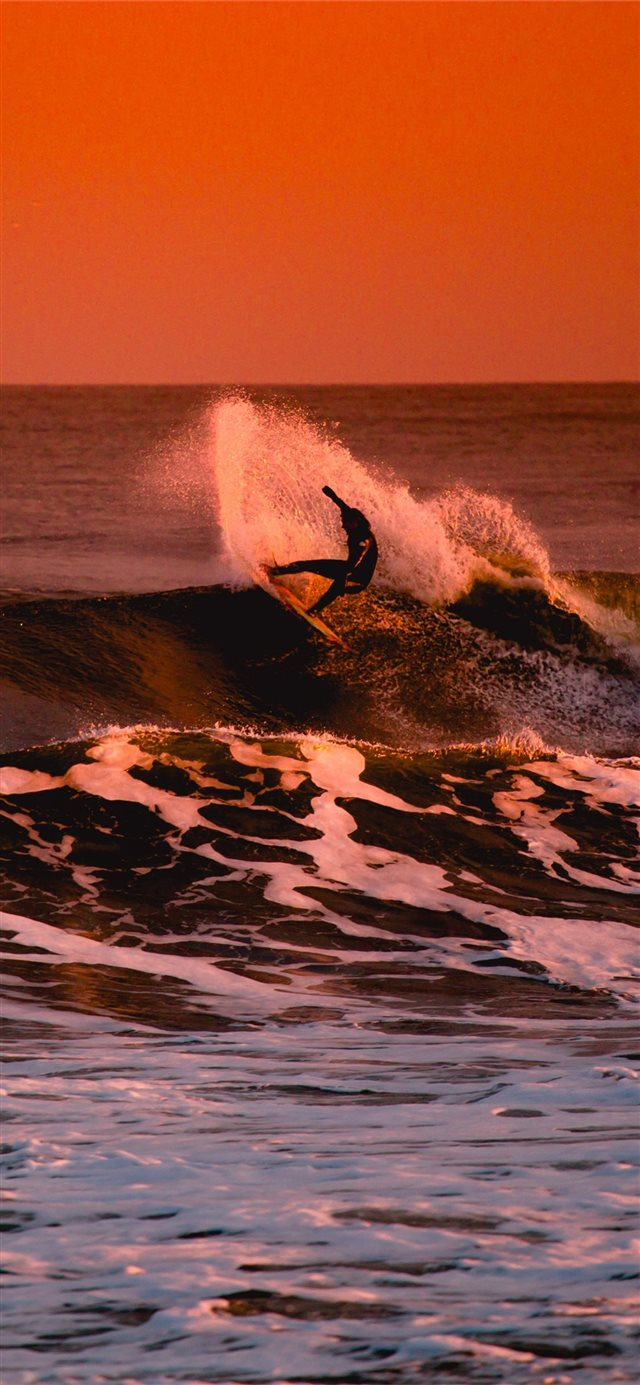 Person Surfing During Sunset Iphone X Wallpapers Free Download