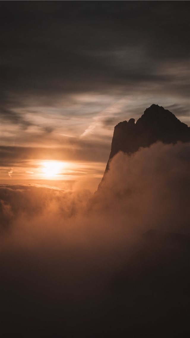 silhouette of mountain under cloudy sky iPhone SE wallpaper
