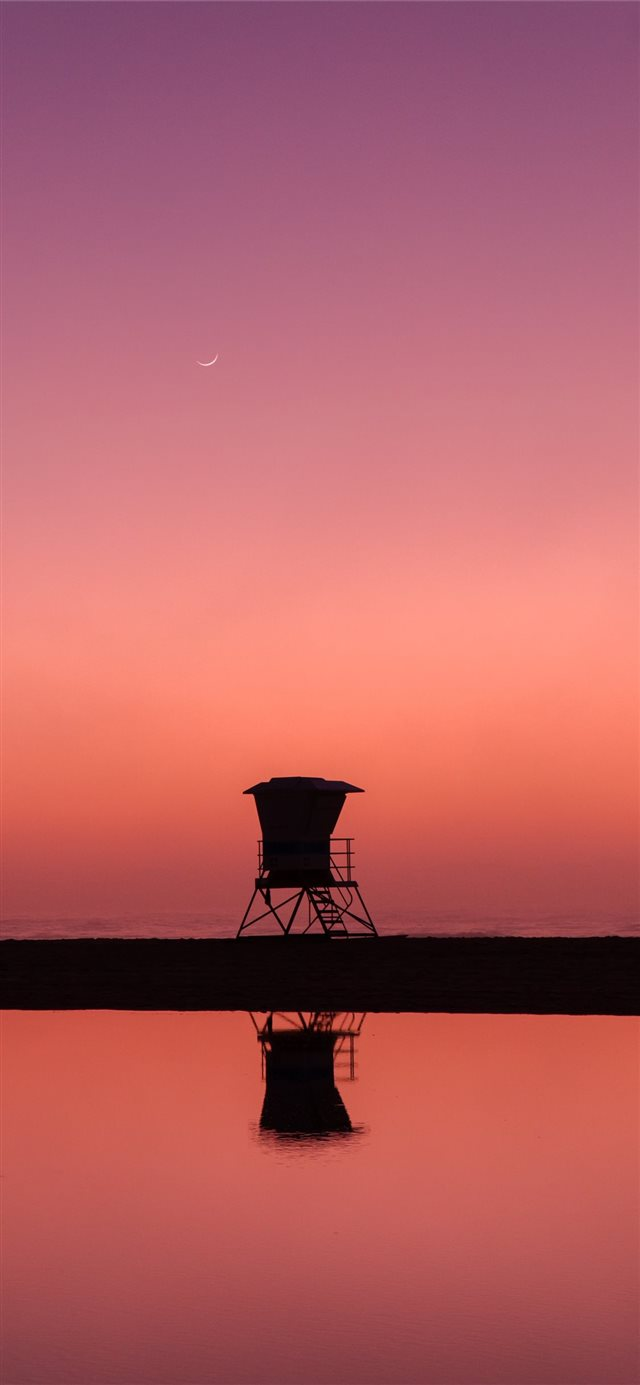 silhouette photo of lifeguard house iPhone X wallpaper