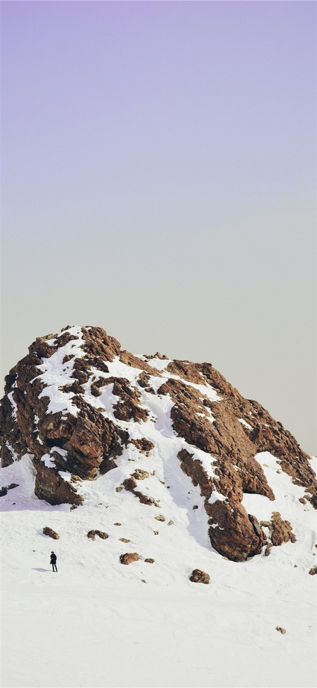 snow covered cliff iPhone X wallpaper
