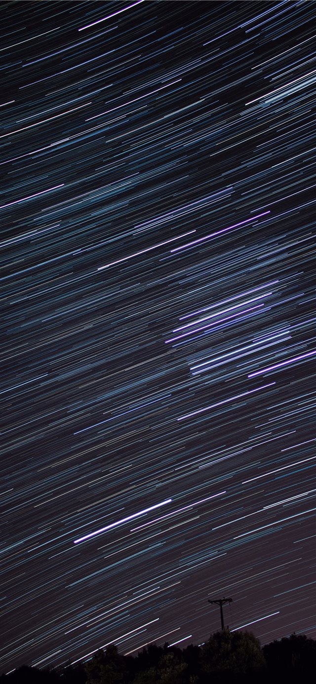 time lapse photography of falling stars iPhone X wallpaper