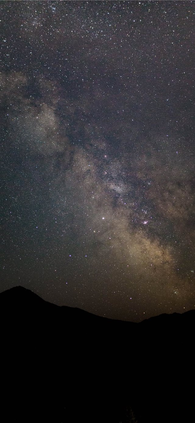 silhouette of mountain under stars iPhone 11 wallpaper