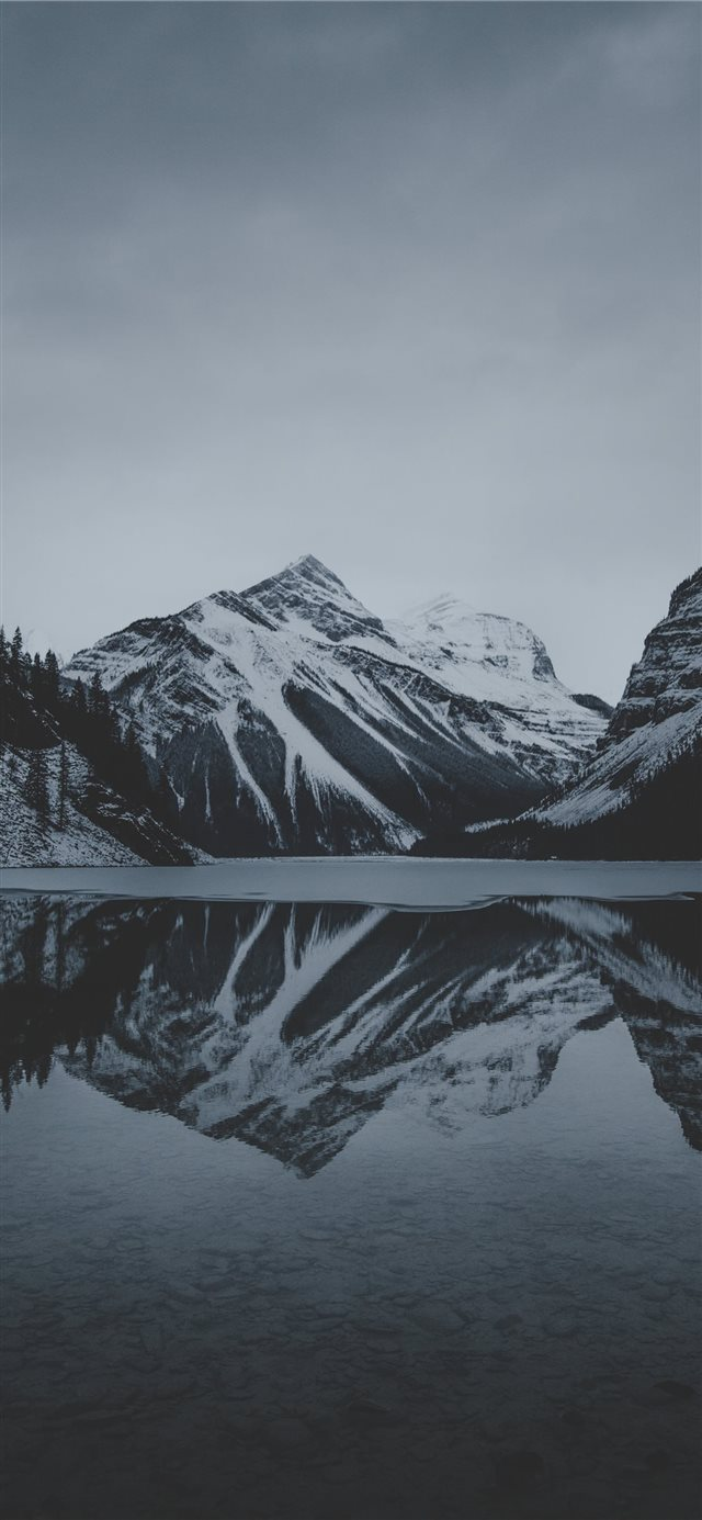 snow mountains and lake undr gray sky iPhone 11 wallpaper