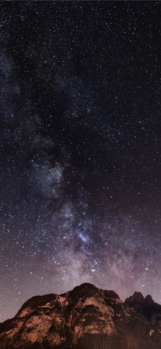 brown and black mountain during starry night iPhone X wallpaper