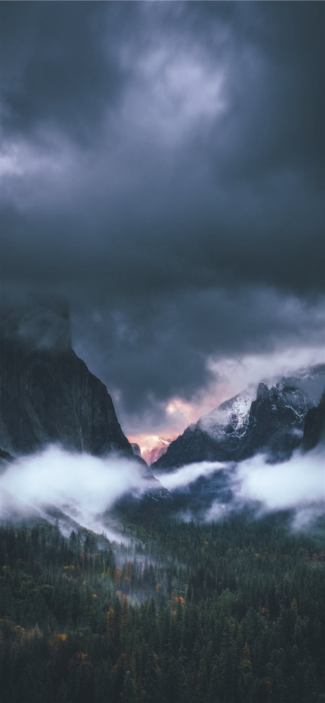 brown rocky mountain under gray sky iPhone 11 wallpaper