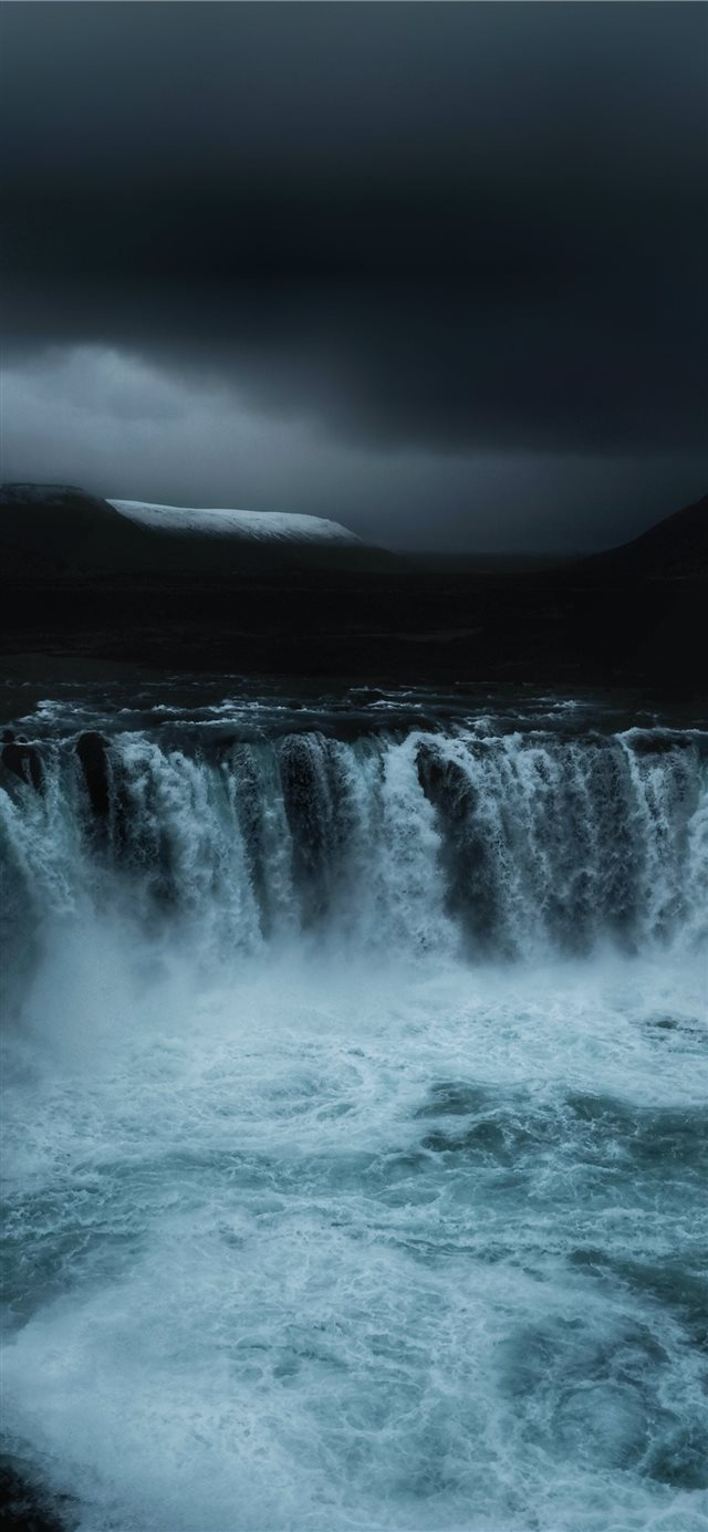 running waterfalls under grey clouds iPhone X wallpaper