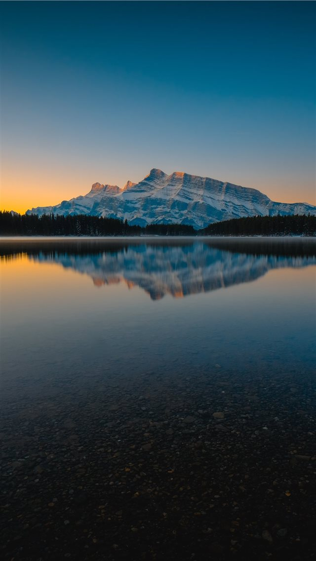 silhouette of mountain and lake iPhone SE wallpaper