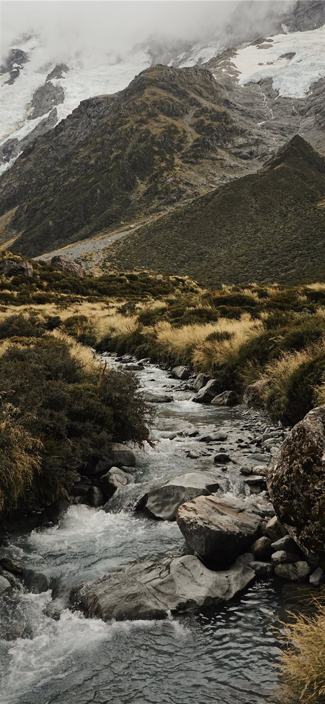 water stream near mountains iPhone X wallpaper
