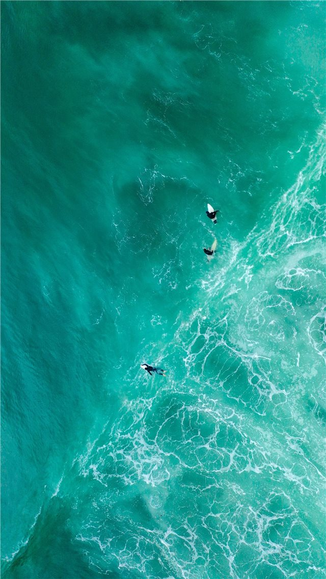 aerial photography of surfers on sea iPhone SE wallpaper