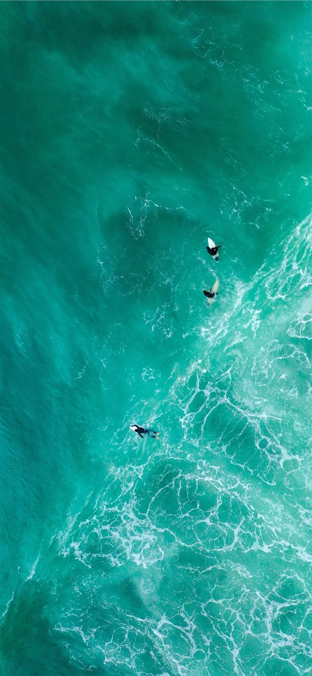 aerial photography of surfers on sea iPhone X wallpaper