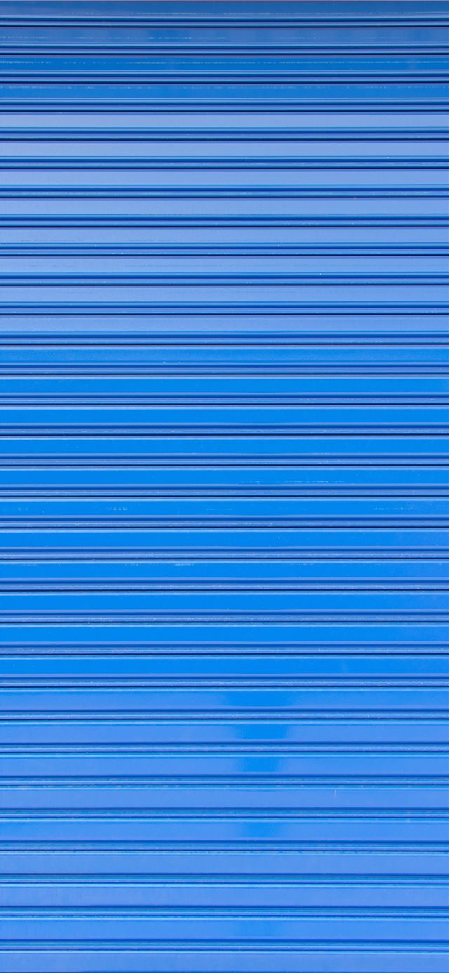 Blue roller shutter of a warehouse iPhone X wallpaper