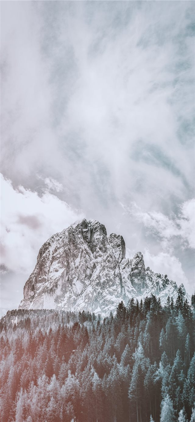 mountain covered with snow under white cloud and b... iPhone X wallpaper