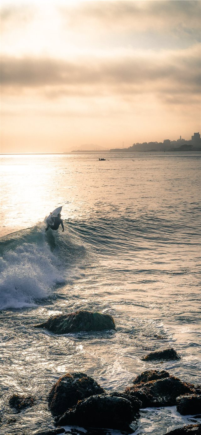 person surfing iPhone X wallpaper