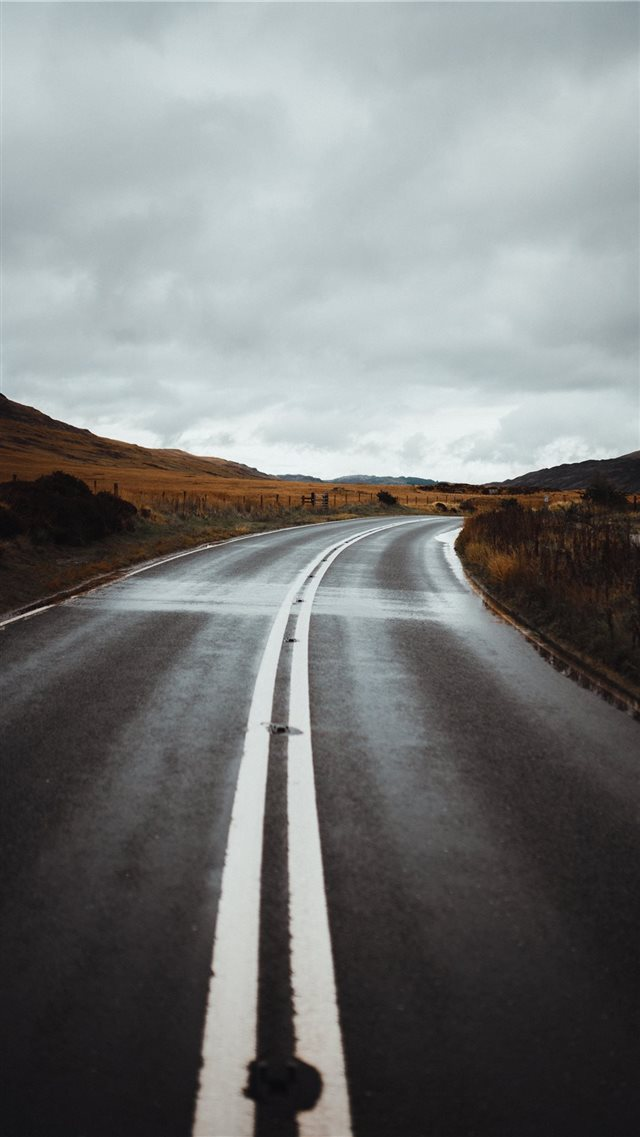 road under cloudy sky iPhone SE wallpaper