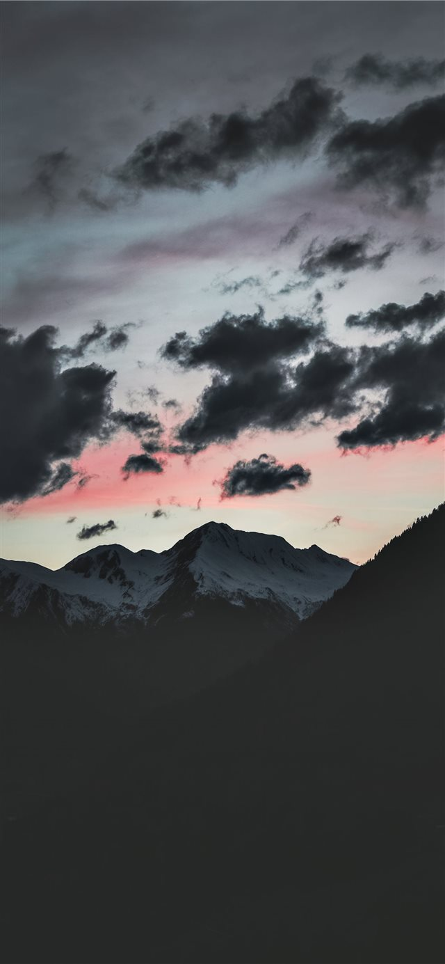 silhouette of mountain under cloudy sky iPhone 11 wallpaper