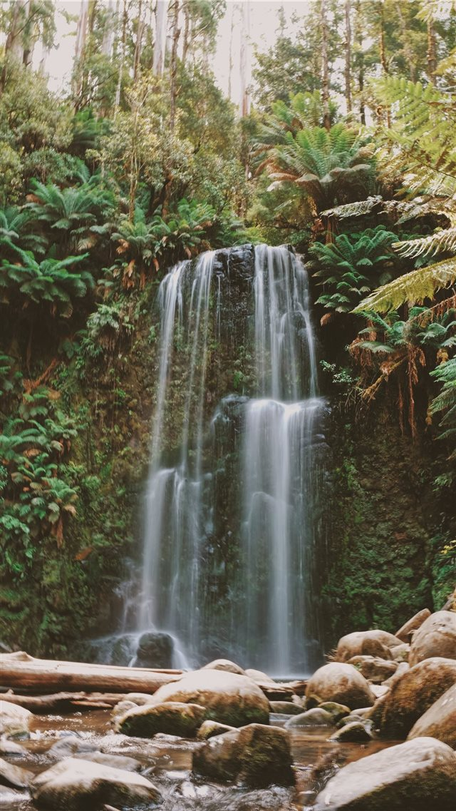 timelapse photo of waterfall facing rocks iPhone SE wallpaper