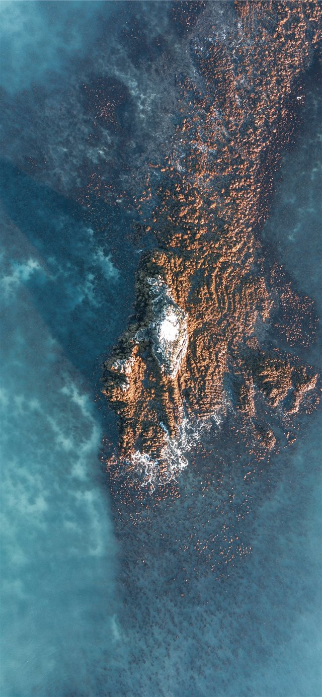 aerial photo of islet iPhone 11 wallpaper