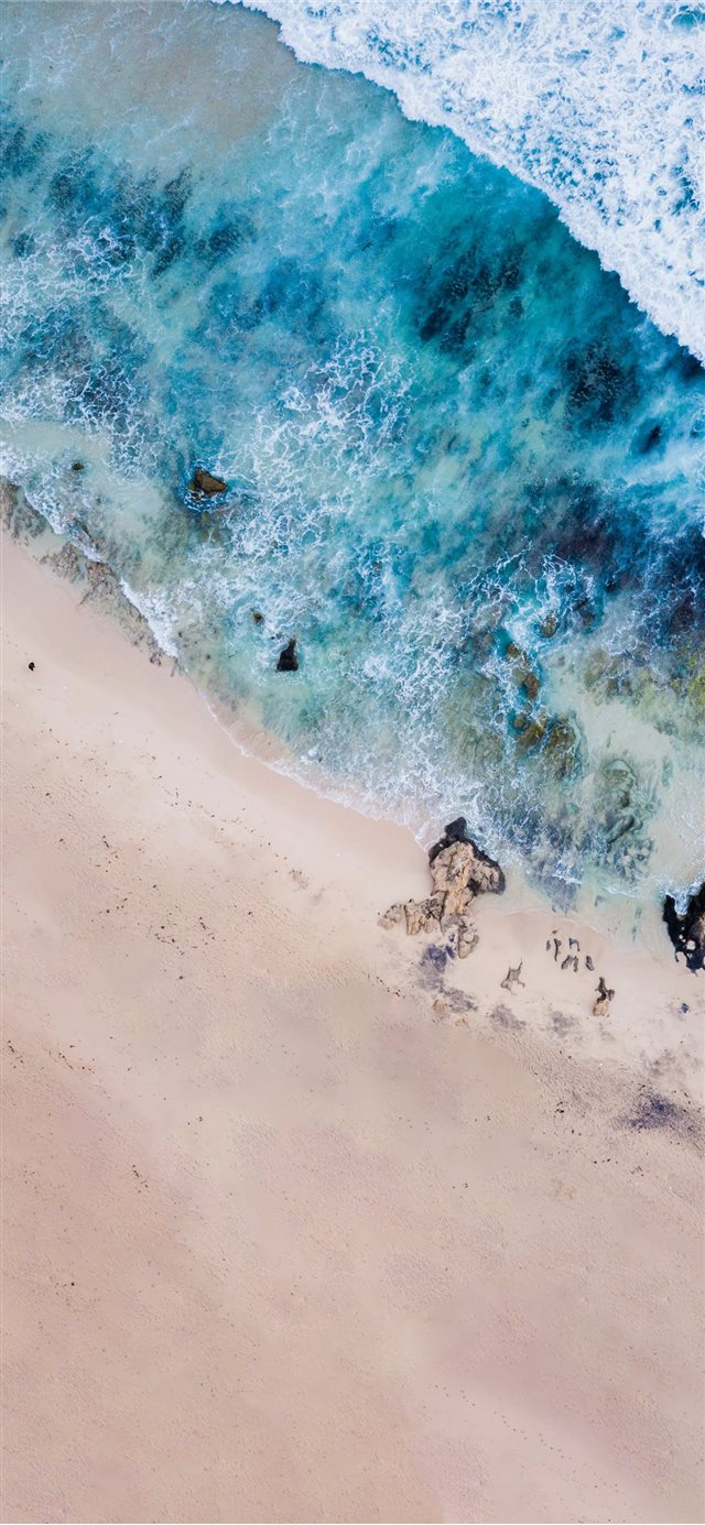 bird's eye photography of body of water near shore iPhone X wallpaper