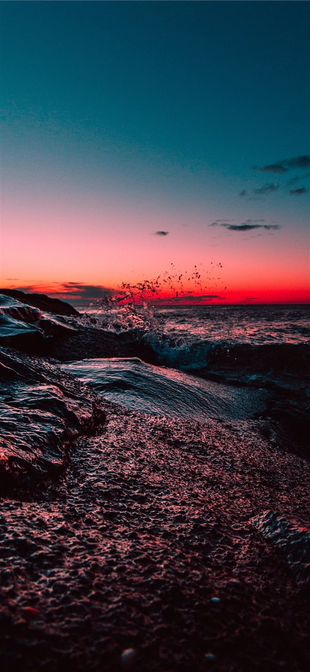 body of water during sunset iPhone 11 wallpaper
