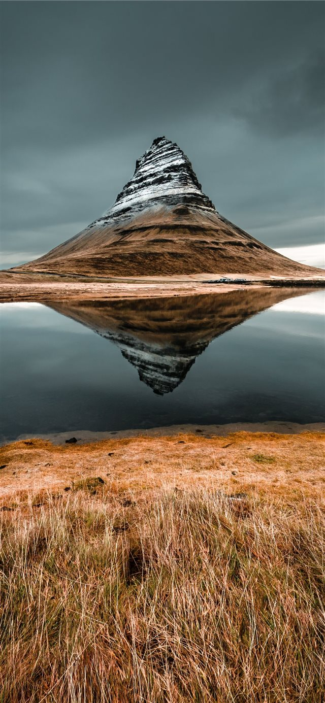 cone mountain with the distance of body of water iPhone 11 wallpaper
