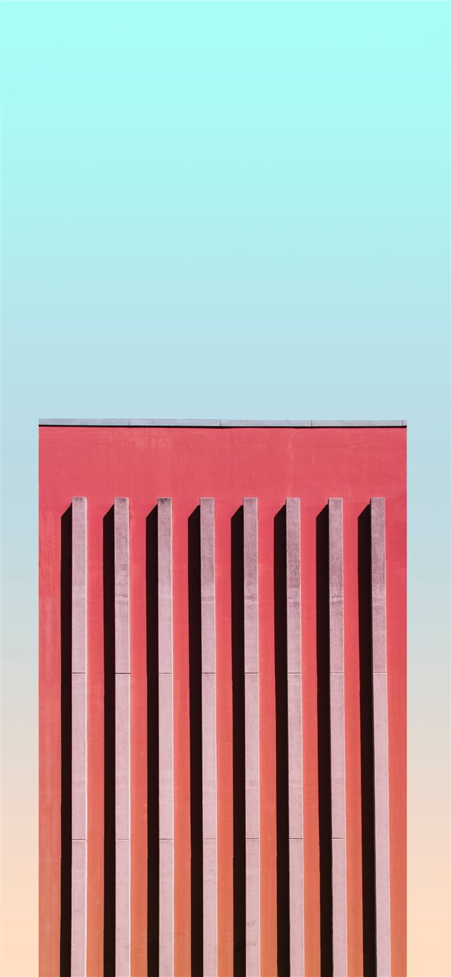 orange high rise building iPhone X wallpaper