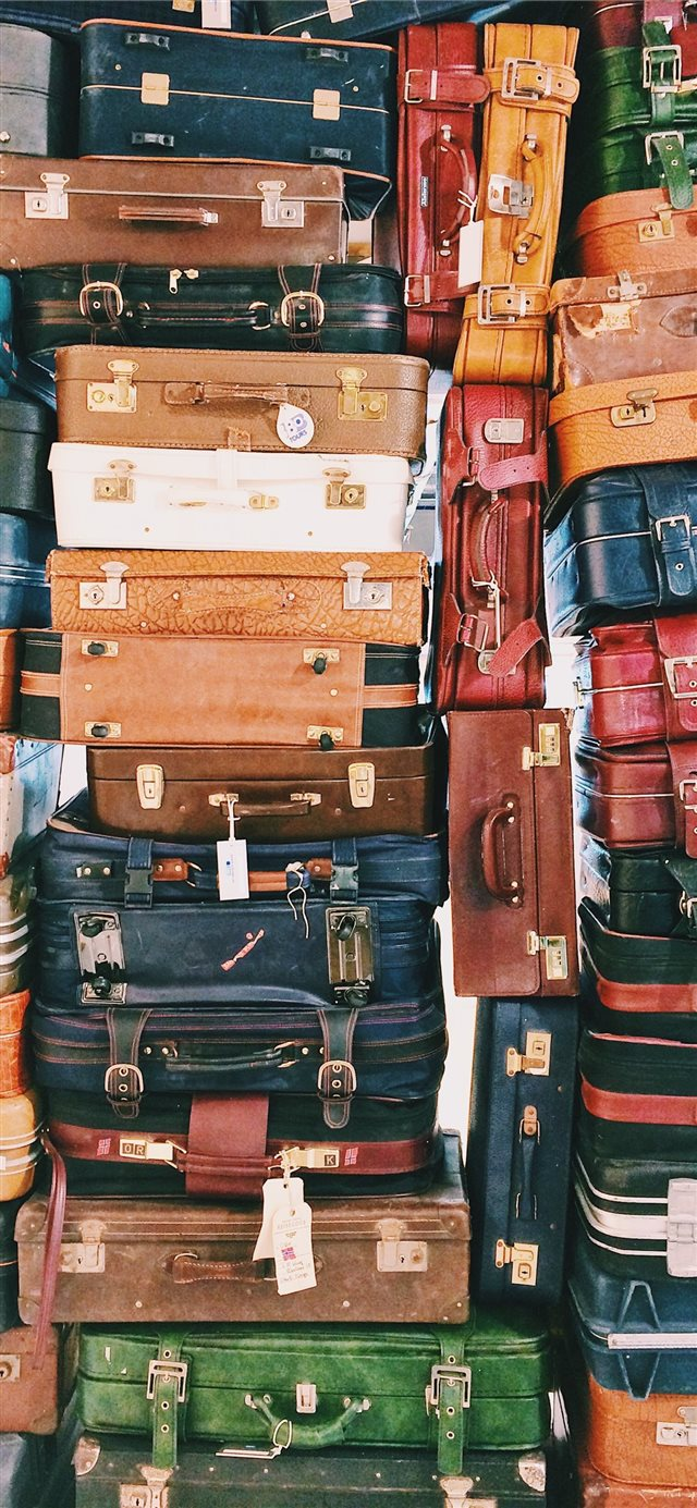 pile of luggages iPhone 11 wallpaper
