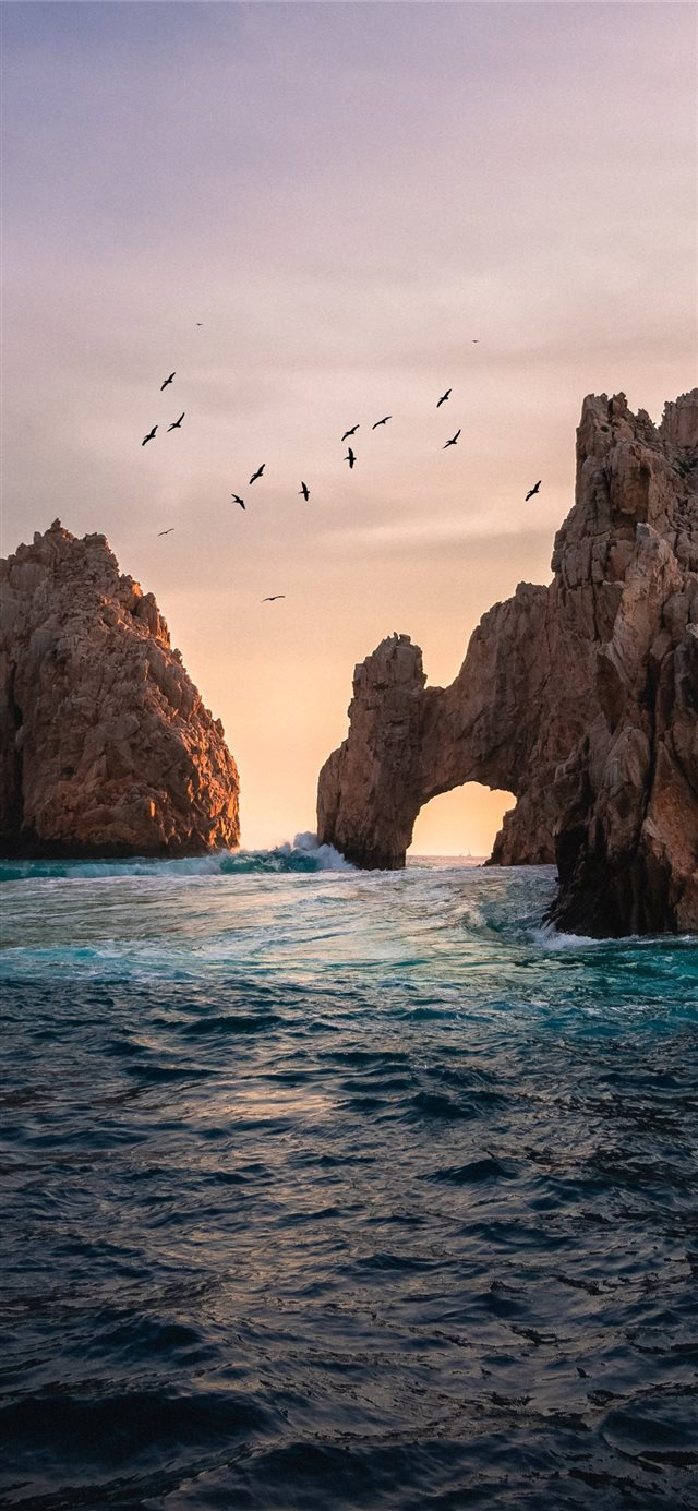 rock formation on the ocean photography iPhone X wallpaper