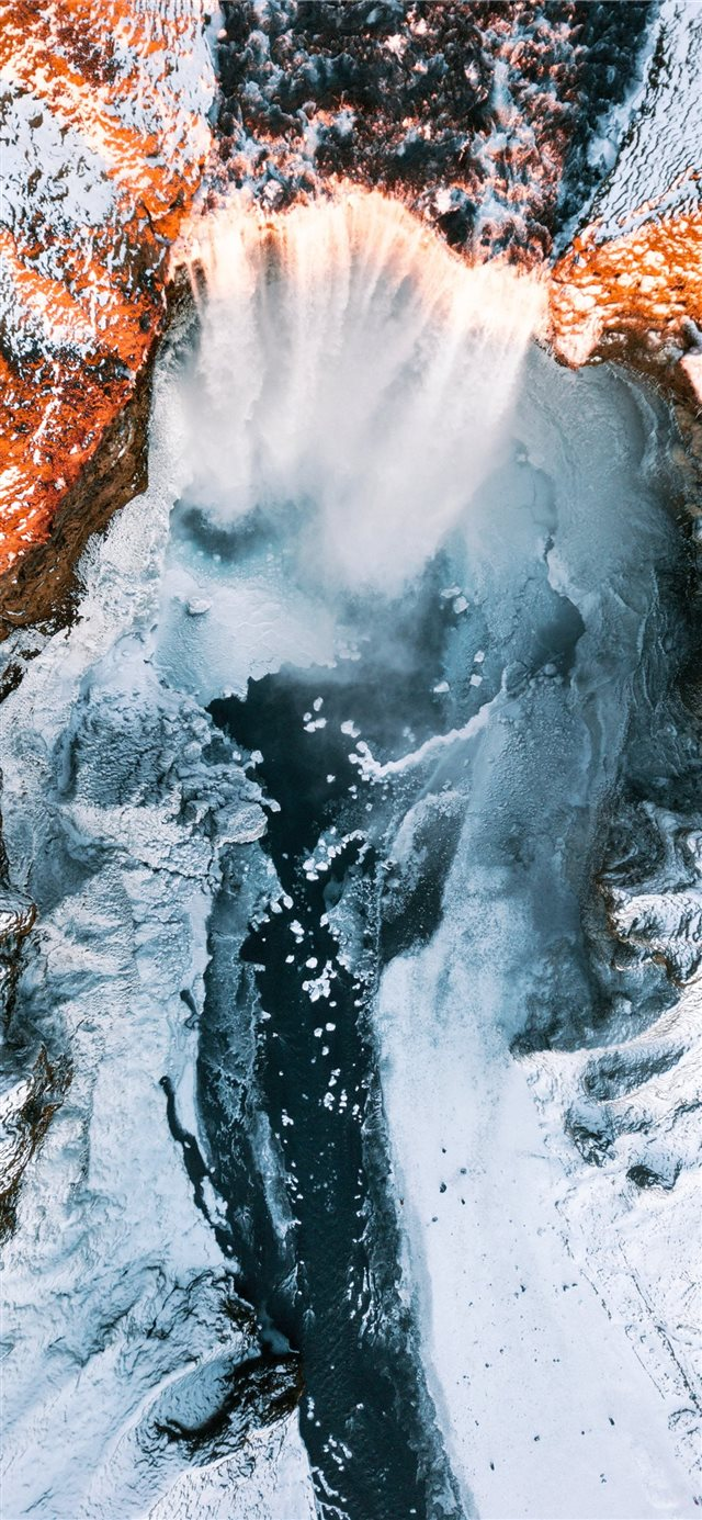waterfalls in between of white rock formation iPhone 11 wallpaper