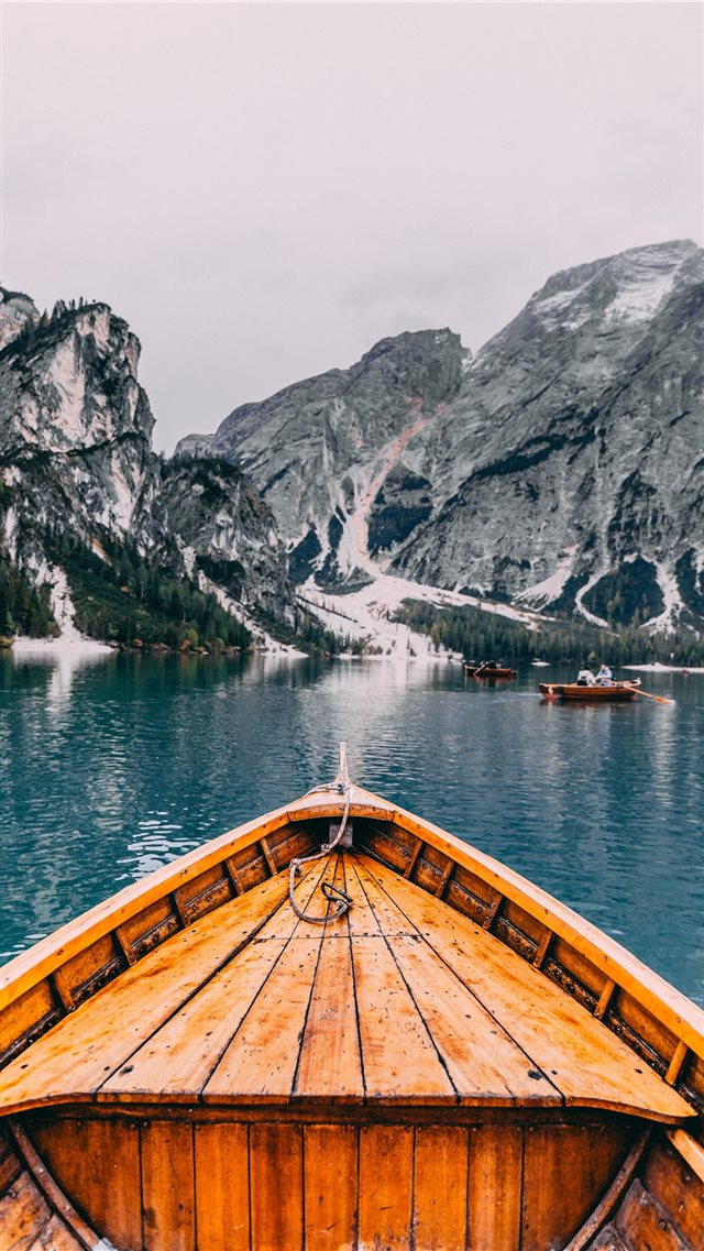 people in brown wooden boat iPhone SE wallpaper