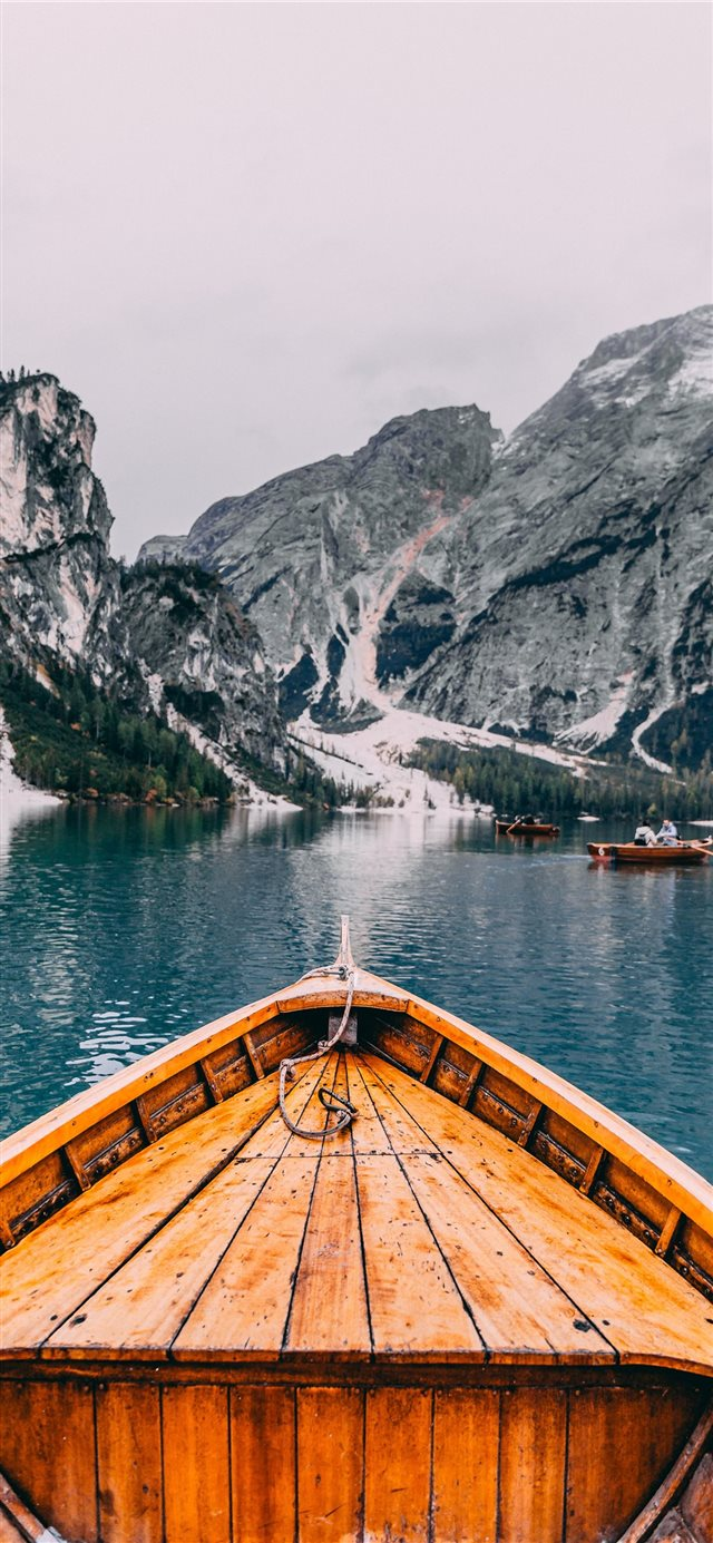 people in brown wooden boat iPhone X wallpaper
