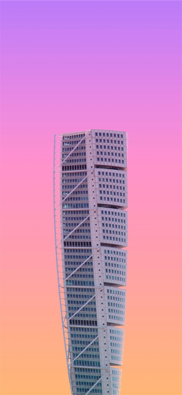 white high rise building under a purple sky iPhone X wallpaper