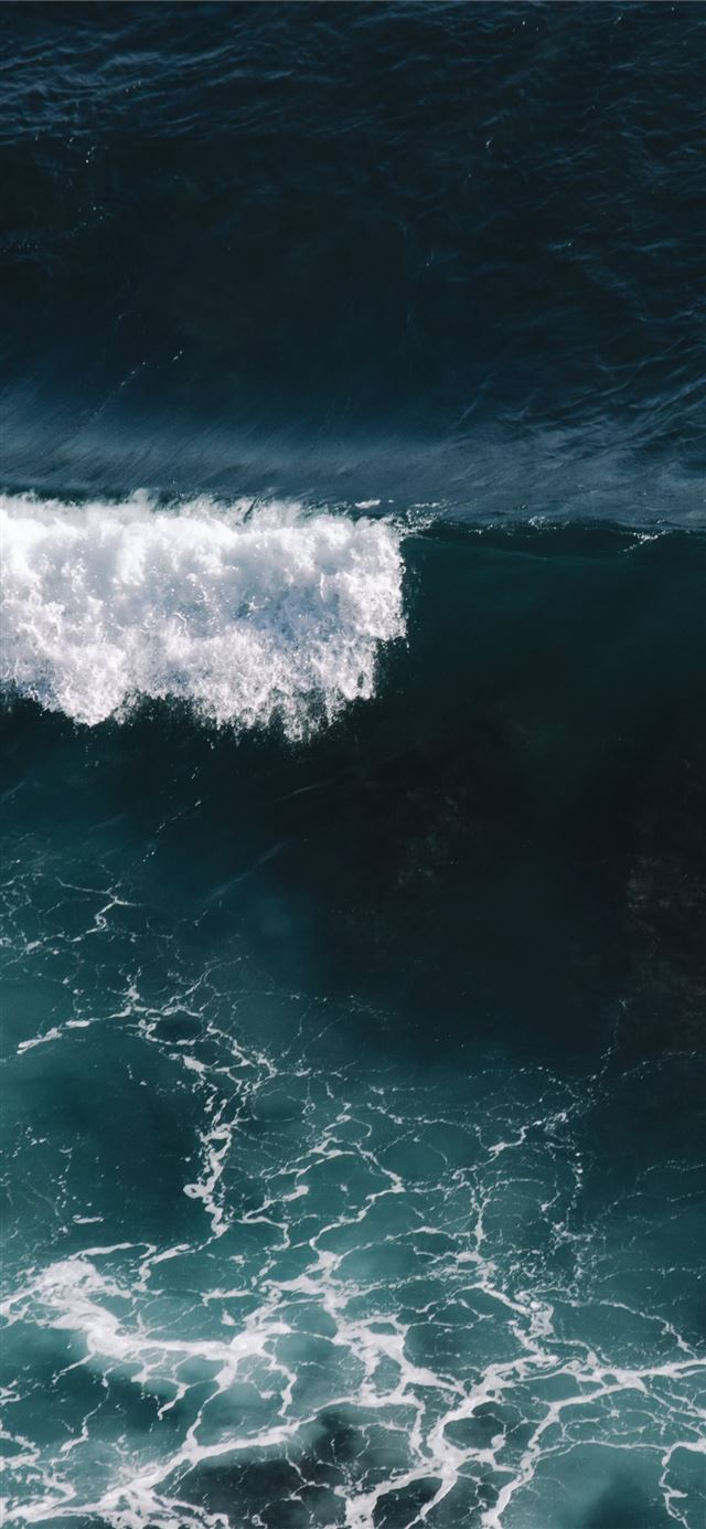 aerial view of ocean waves iPhone X wallpaper