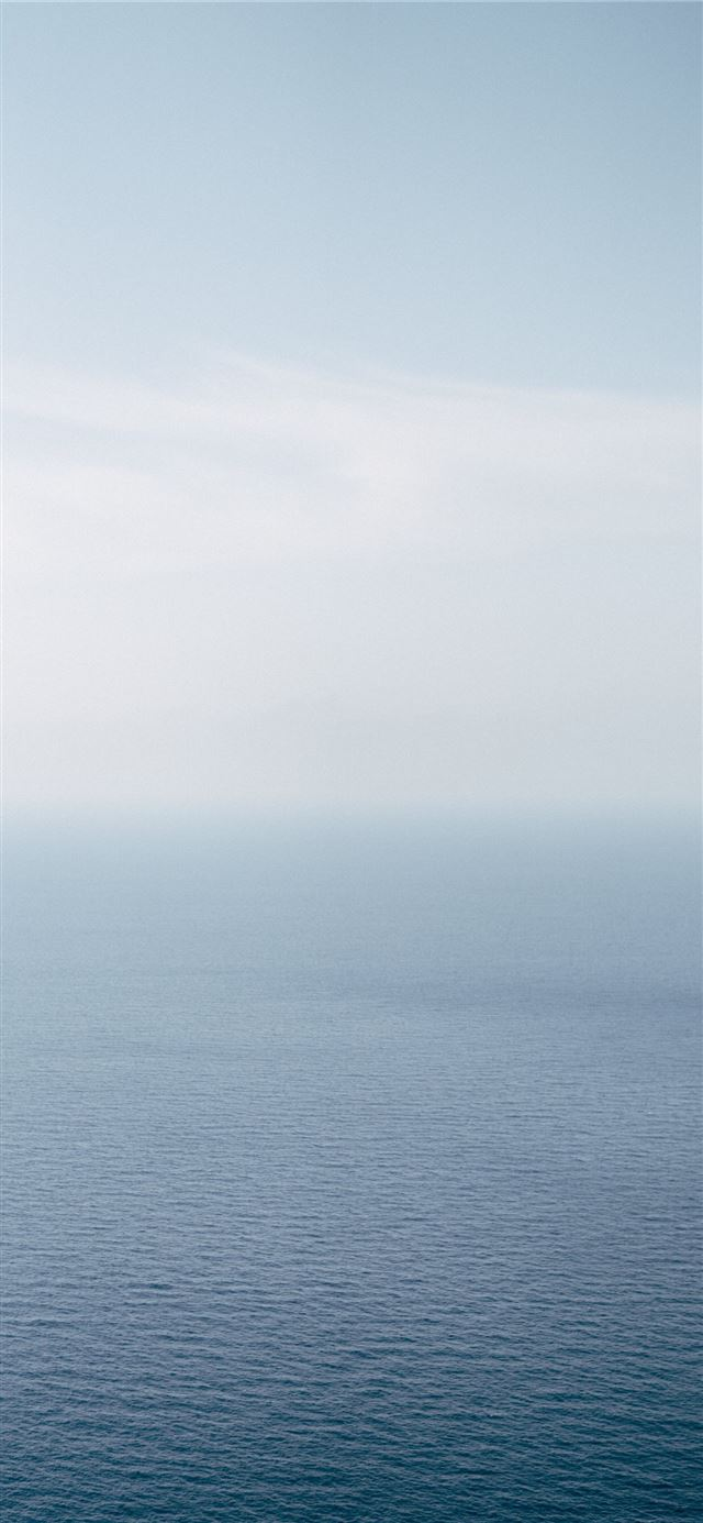 calm body of water iPhone X wallpaper
