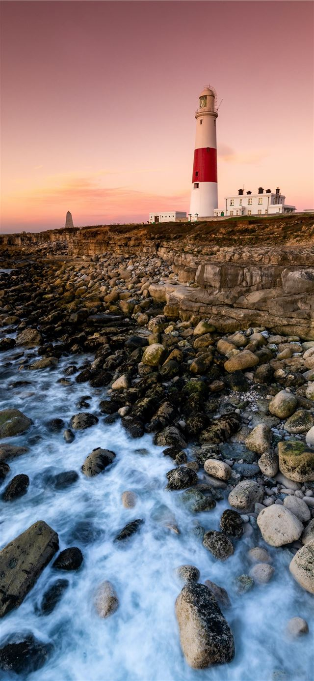 lighthouse near body of water iPhone X wallpaper
