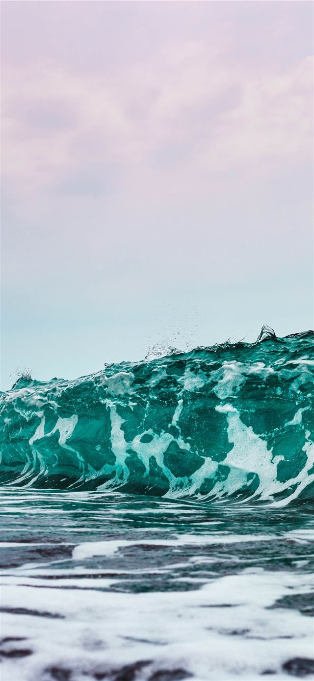 person surfing on sea waves during daytime iPhone 11 wallpaper