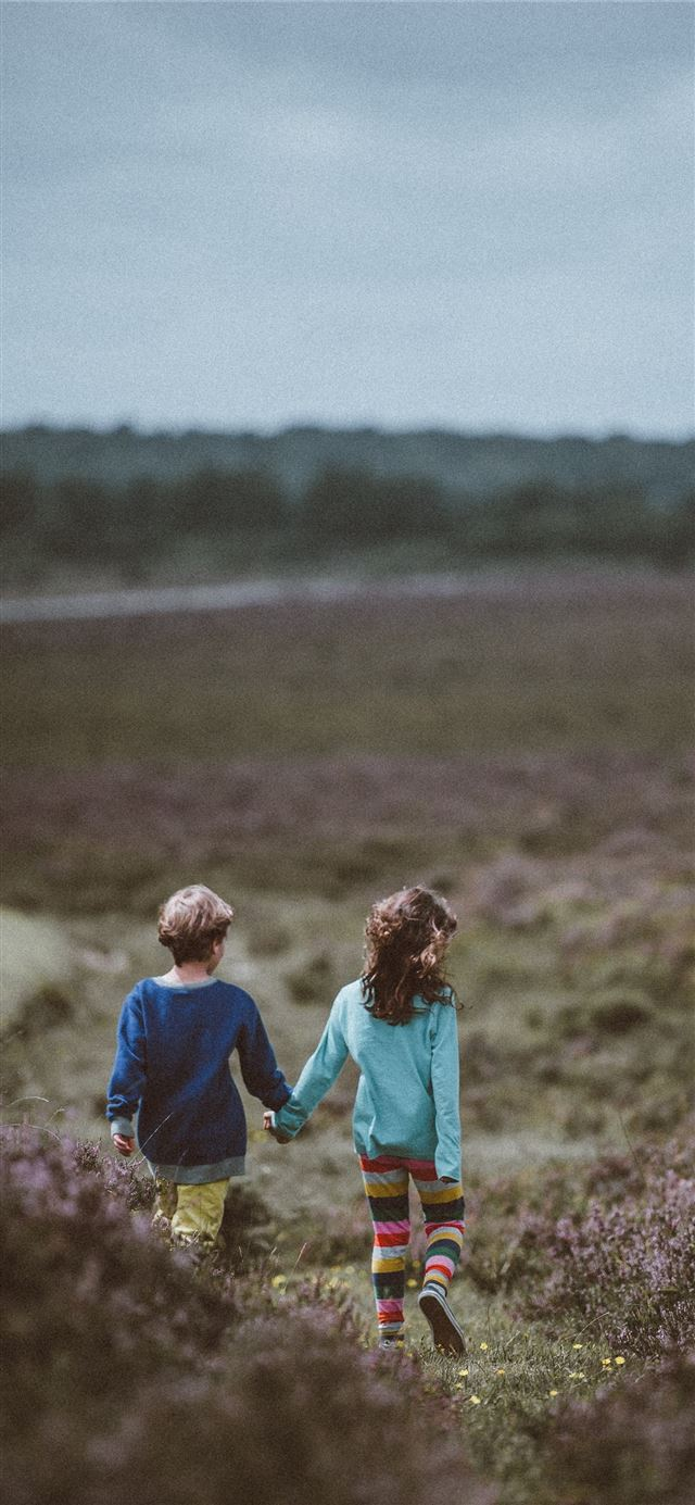 siblings walking holding hands and background iPhone X wallpaper
