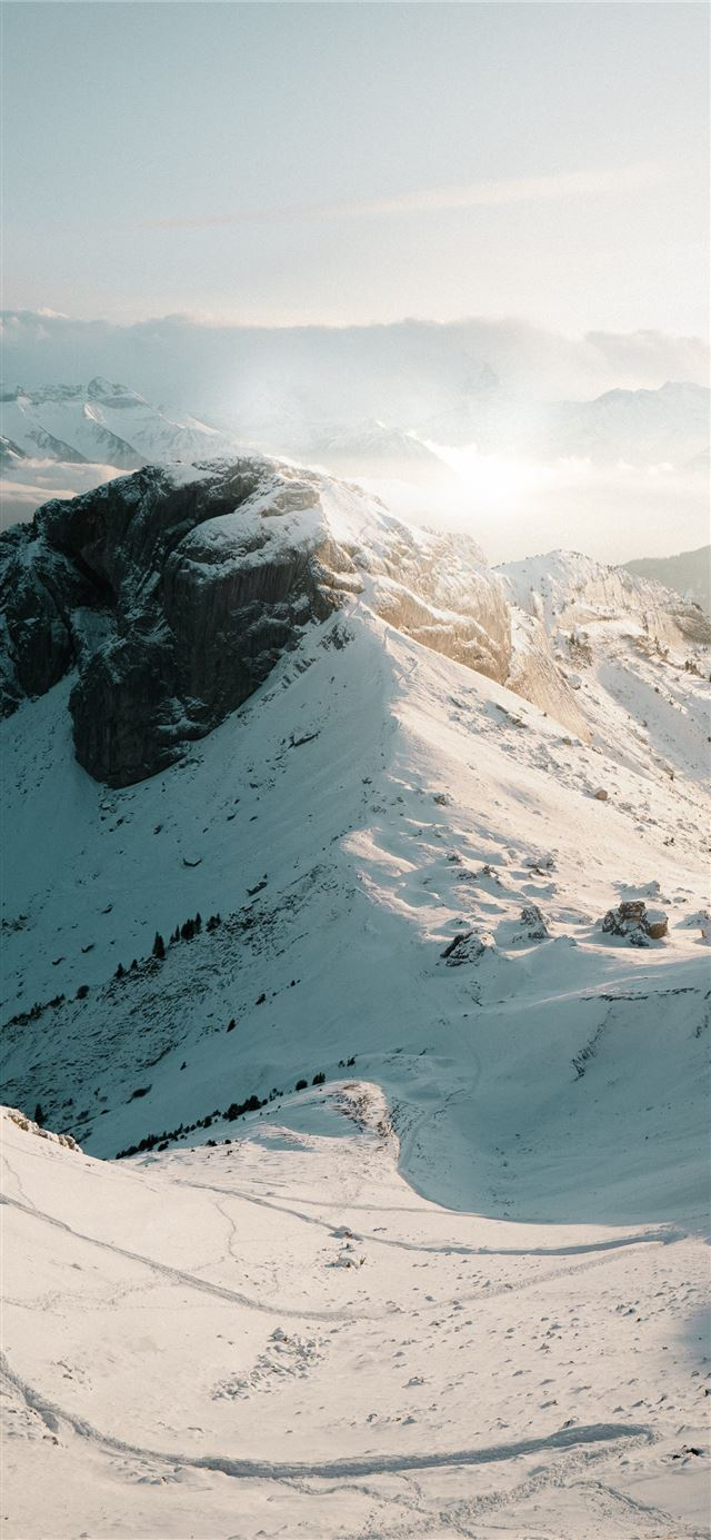 snow covered mountain during daytime iPhone 11 wallpaper