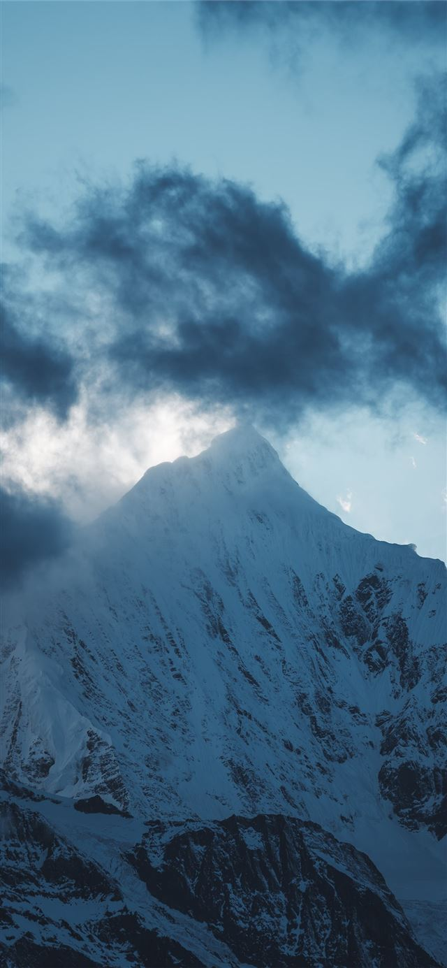 snow covered mountain under gray clouds at daytime iPhone X wallpaper
