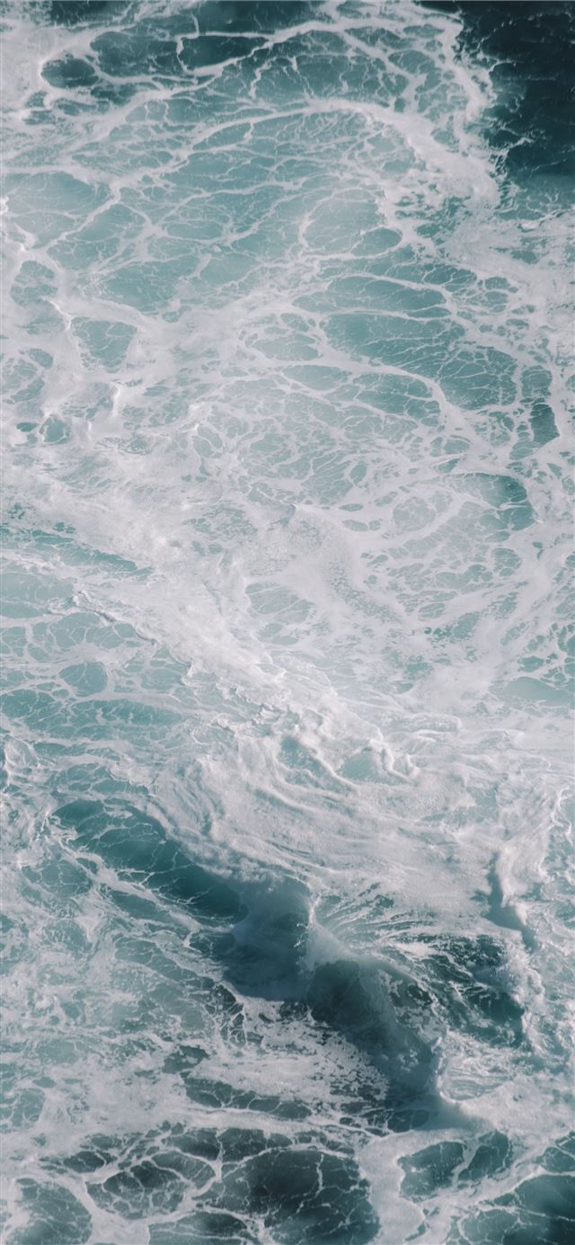 white and blue water waves iPhone 11 wallpaper