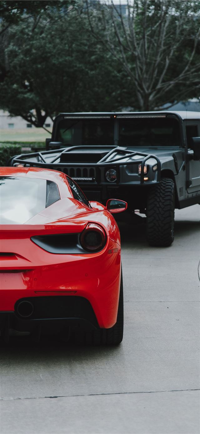 red Ferrari car and black Hummer SUV iPhone 11 wallpaper