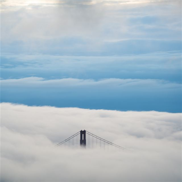 aerial view of bridge under clouds 8k iPad Pro wallpaper